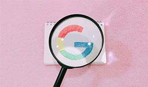 Google search showing magnifying glass with Google logo below it