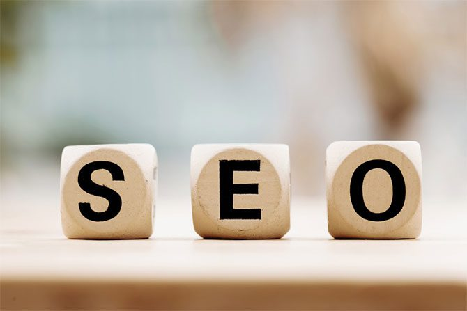Wood blocks spelling out SEO meaning Search Engine Optimization