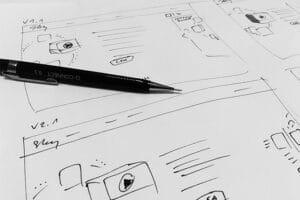 Responsive website design mockup being drawn on paper